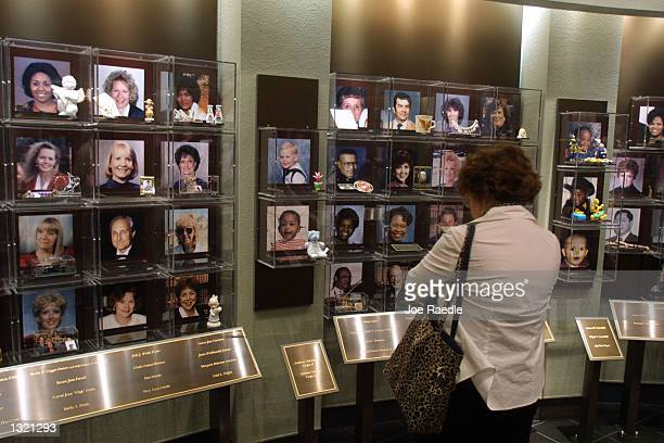 Visitors look at the faces of the victims of the 1995 Oklahoma City bombing June 11 2001 at the Oklahoma National Memorial in Oklahoma City Oklahoma...