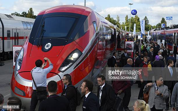 Visitors look at the fastest train in Europe the Frecciarossa 1000 by Bombardier during the opening day of the Innotrans International Trade Fair for...
