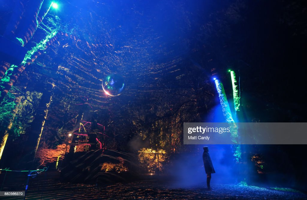 Visitors look at the illuminations at the launch of Enchanted Christmas attraction at Westonbirt Arboretum near Tetbury on November 29, 2017 in Gloucestershire, England. The popular annual attraction, which features illuminations and interactive features along the trail, will take place on long weekends from the 1 December until 18 December.