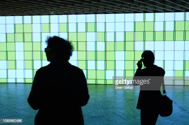 Visitors look at the installation 'Light Shadows Clues' based on a work by Laszlo MoholyNagy at 'Bauhaus 100 Years The Opening Festival' during a...