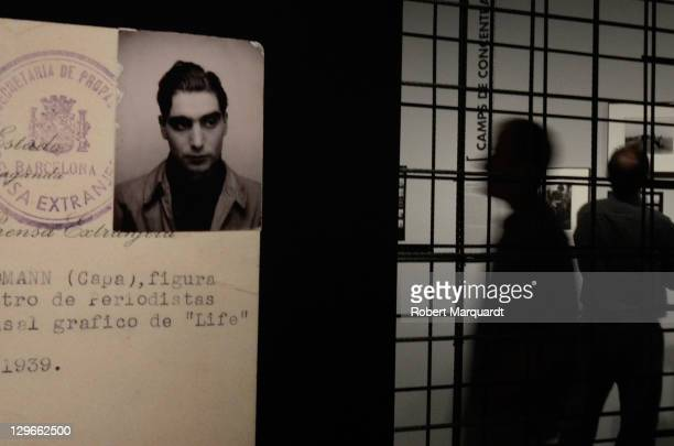 Visitors look at 'The Mexican Suitcase' exhibition at the National Art Museum of Catalunya on October 19 2011 in Barcelona Spain The Exhibition...