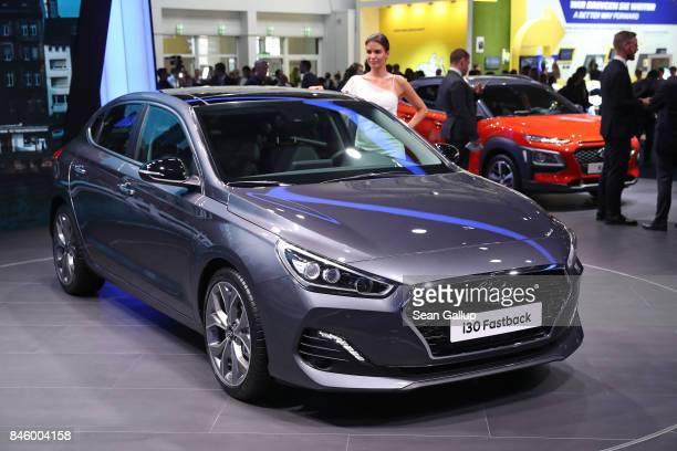 Visitors look at the new Hyundai i30 Fastback passenger car at the 2017 Frankfurt Auto Show on September 12 2017 in Frankfurt am Main Germany The...