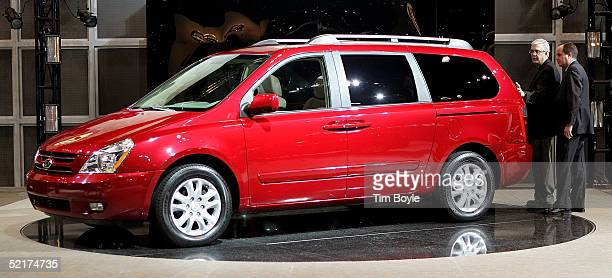 Visitors look at the new Kia Sedona minivan at the 2005 Chicago Auto Show February 10 2005 in Chicago Illinois This is the 97th edition of the...