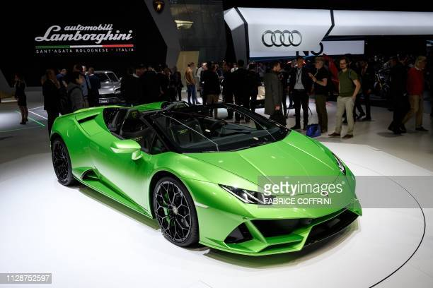 Visitors look at the new Lamborghini Huracan Evo Spyder model car on March 5, 2019 during a press day ahead of the Geneva International Motor Show in...