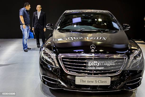 Visitors look at the new SClass by MercedesBenz display at The 22st Indonesia International Motor Show 2014 on September 18 2014 in Jakarta Indonesia...