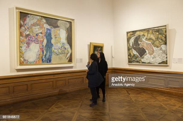 Visitors look at the oil painting The Bride at the World's largest collection of Gustav Klimt at the Upper Belvedere Belvedere Palace in Vienna...