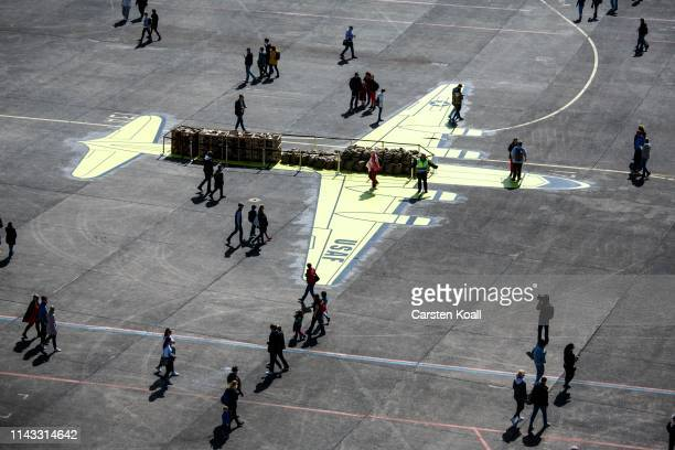 """Visitors look at the on the ground painted plane Douglas C-54, called a """"Rosinenbomber"""" shown at a celebration to mark the 70th anniversary of the..."""