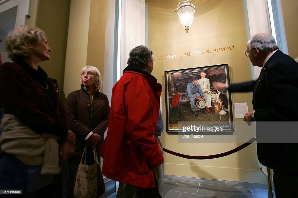Visitors Look At The Original Norman Rockwell Painting Entitled Breaking Home Ties Which