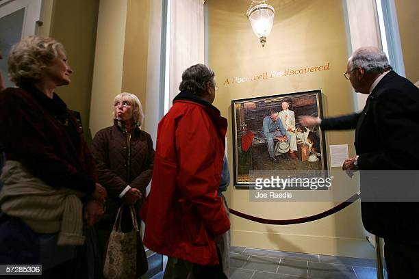 """Visitors look at the original Norman Rockwell painting entitled """"Breaking Home Ties,"""" which was painted for the September 25, 1954 cover of The..."""