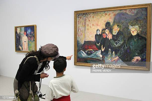 Visitors look at the painting 'Combat contre la mort' at the Centre Pompidou modern art museum also known as the 'Centre Beaubourg' during the Edvard...