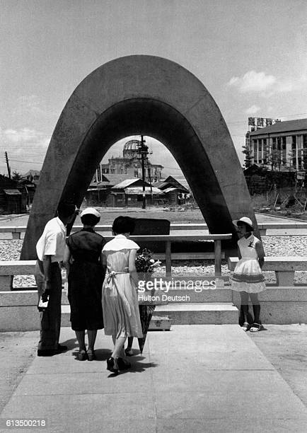 Visitors look at the Peace Memorial in Hiroshima Japan in August 1955 the tenyear anniversary of the city's destruction by an atomic bomb dropped by...