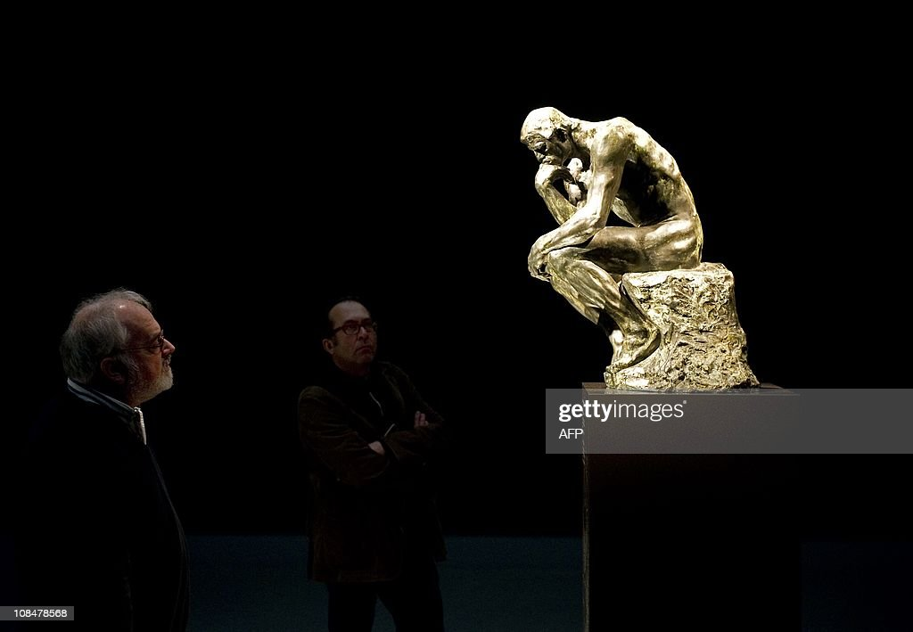 Visitors look at the restored statue 'The Thinker' by Auguste Rodin at the Singer Laren museum on January 28, 2011. Rodin's The Thinker, along with six other bronze statues, was stolen from the museum in 2007 and was recovered two days later seriously damaged. The restored sculpture returned at the Singer Laren museum for a public exhibition which will be held from January 28 to May 22, 2011. AFP PHOTO / ANP / TOUSSAINT KLUITERS netherlands out - belgium out