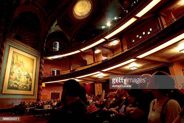 Visitors look at the restored theater during a tour of the Palace Theater in downtown Los Angeles Ca presented by the Los Angeles Theater Historic...