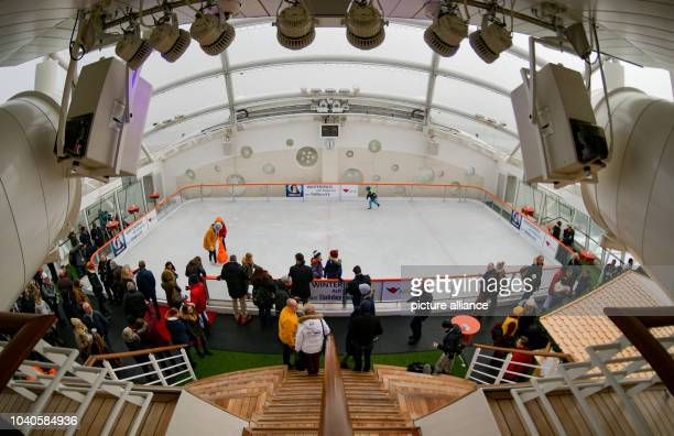 Visitors look at the rink on the deck of the 'Aida prima' cruise ship in Hamburg Germany 12 November 2016 AIDA cruises is opening Hamburg's newest...