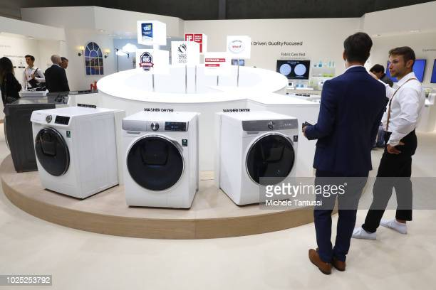 Visitors look at the Samsung Home appliance Washing Machines at the 2018 IFA consumer electronics and home appliances trade fair during the fair's...