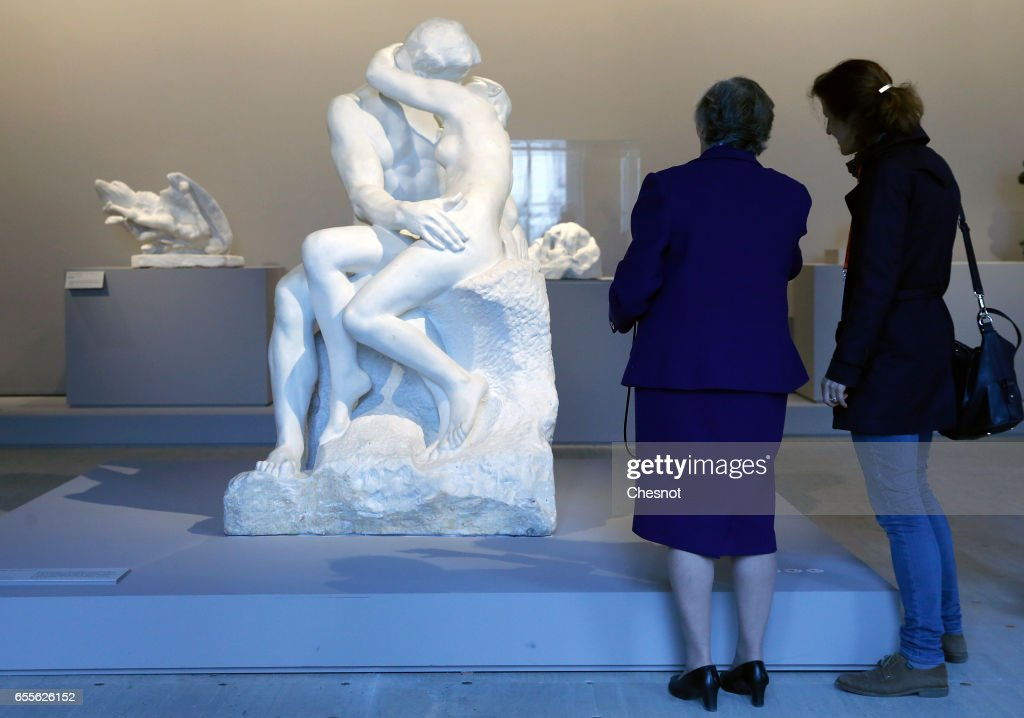 Visitors look at the sculpture 'The Kiss 1881-1882' by French sculptor Auguste Rodin (1840-1917) during the press preview 'Rodin the centennial exhibition' at the Grand-Palais on March 20, 2017 in Paris, France. To mark the centenary of his death, the Rodin museum and the Grand-Palais are joining forces to celebrate Auguste Rodin (1840-1917). This exhibition takes part from March 22 to July 31, 2017.