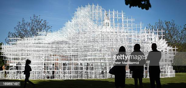 Visitors look at the Serpentine Gallery Pavilion on June 4 2013 in London England Designed by Japanese architect Sou Fujimoto it occupies 357...