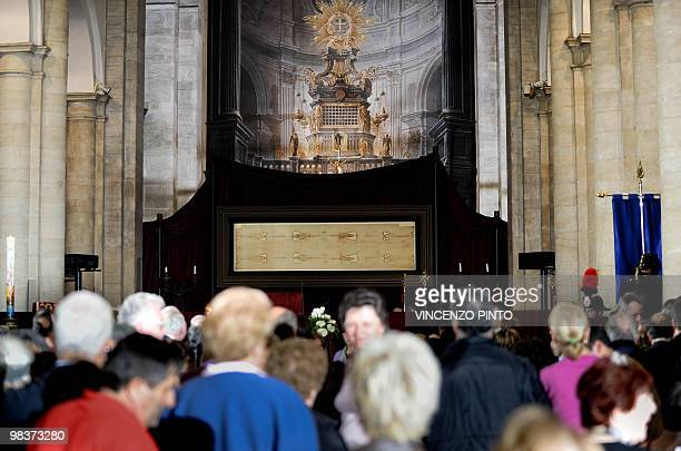 Visitors look at the Shroud of Turin on the first day of its public display in ten years on April 10 2010 in the Cathedral in Turin The mysterious...