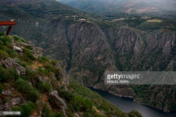 Visitors look at the Sil Canyon from the Cividade viewpoint near the village of Sober in the Galicia region of northwestern Spain on July 21 2018 The...