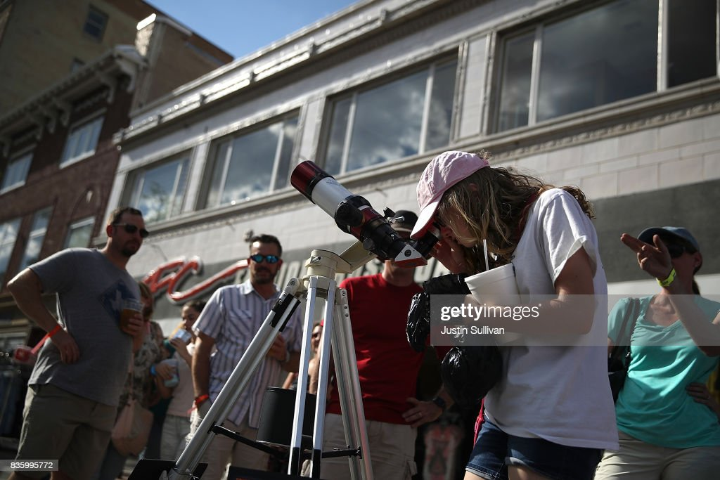 Visitors look at the sun through a telescope during the Wyoming Eclipse Festival on August 20, 2017 in Casper, Wyoming. Thouands of people have descended on Casper, Wyoming to see the solar eclipse in the path of totality as it passes over the state on August 21.