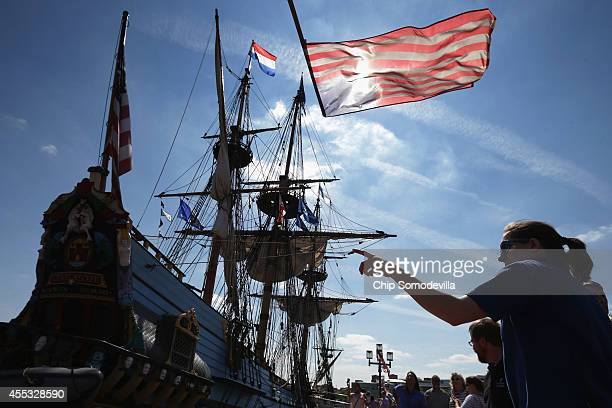 Visitors look at the tall ship Kalmar Nyckel from Wilmington DE where it is docked in the Inner Harbor as part of the Star Spangled Spectacular...