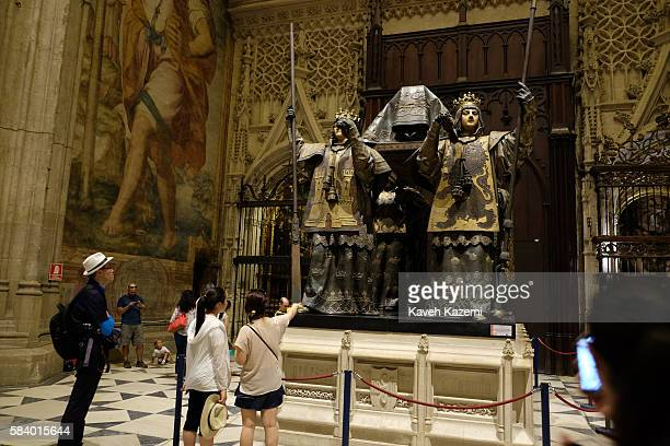 Visitors look at the tomb of Christopher Columbus in Seville Cathedral formerly site of an Islamic Mosque on June 25 2016 in Seville Spain Seville...