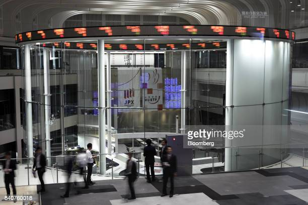 Visitors look at the trading floor at the Tokyo Stock Exchange operated by Japan Exchange Group Inc in Tokyo Japan on Wednesday Aug 30 2017 Equity...