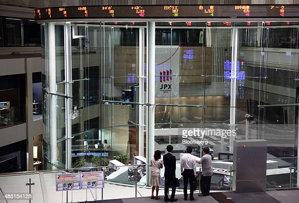 Visitors look at the trading floor of the Tokyo Stock Exchange operated by Japan Exchange Group Inc in Tokyo Japan on Tuesday Aug 25 2015 Japanese...