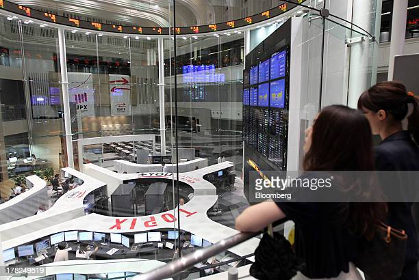 Visitors look at the trading floor of the Tokyo Stock Exchange in Tokyo, Japan, on Wednesday, Aug. 28, 2013. Japanese shares declined, with the Topix...