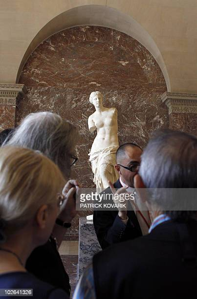Visitors look at the Venus de Milo during the inauguration of the new rooms consecrated to the Classic and Hellenistic Greek arts at the Louvre...