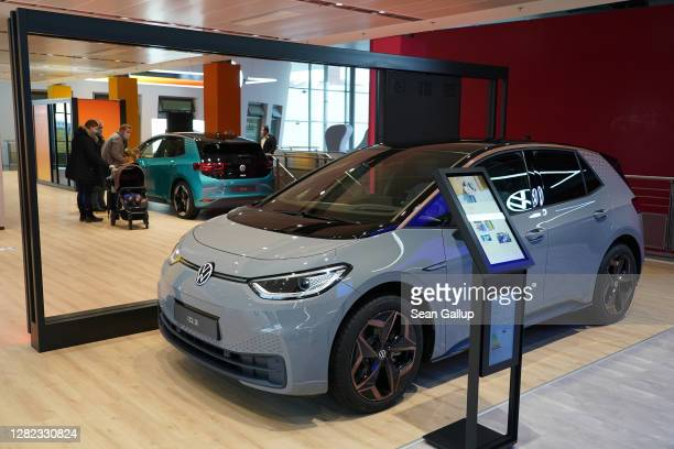 Visitors look at Volkswagen ID.3 electric cars at the Autostadt promotional facility next to the Volkswagen factory on October 26, 2020 in Wolfsburg,...
