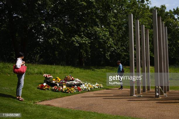 Visitors look at wreaths and flowers of condolence marking 14 years to the day since the 7/7 bombings at the 7 July Memorial in Hyde Park in London...