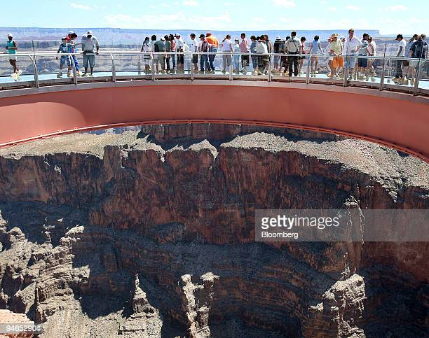 Visitors look down into the Grand Canyon from the Skywalk Sunday Aug 12 2007 The Grand Canyon Skywalk which opened in March 2007 was commissioned by...