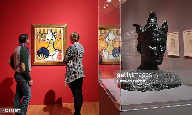 Visitors look for a picture of Alexis HrodockJeanneau the 'Esprit Mont Martre' exhibition right a sculpture of Pablo Picasso at Schirn Kunsthalle on...