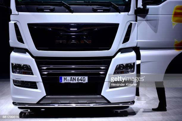 Visitors look on a MAN Truck during the company's annual general shareholders meeting on May 10 2017 in Hanover Germany While the company has shown...