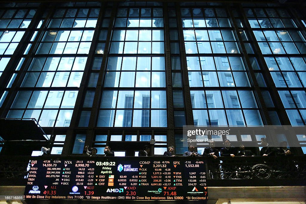 Visitors look out at the floor of the New York stock Exchange at the end of the trading day on April 5, 2013 in New York City. Following news of a disappointing jobs report, U.S. stocks fell Friday.The Dow Jones industrial average lost more than 40 points, or 0.3%, while the S&P 500 fell 0.4%.