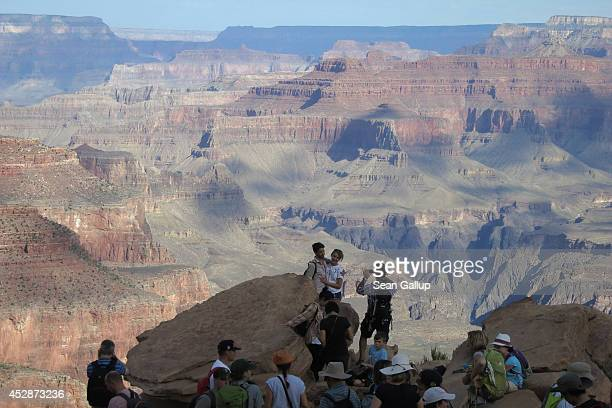 Visitors look out at the Grand Canyon from OohAah Point at the South Rim on July 13 2014 at Grand Canyon National Park Arizona The Grand Canyon is...