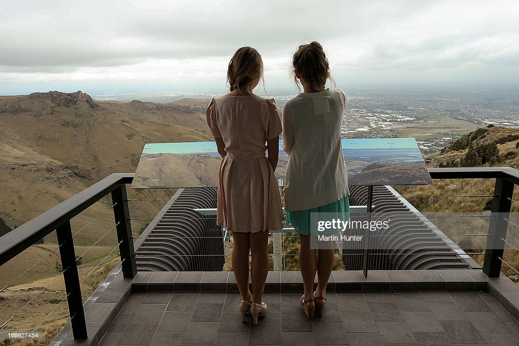 Visitors look out at the view during the re-opening of the Christchurch gondola on April 19, 2013 in Christchurch, New Zealand. The gondola was closed following the 2011 Christchurch earthquakes and has since undergone reconstruction before the official re-opening today.