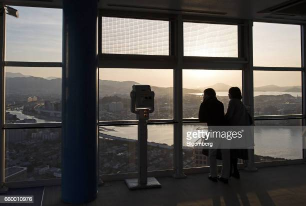 Visitors look out from the observation deck of the Fukuoka Tower in Fukuoka Japan on Friday March 3 2017 Fukuokais the fastestgrowing major city in...
