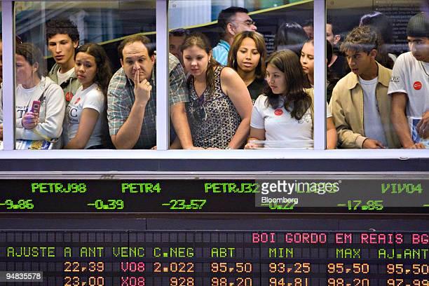 Visitors look out over the trading floor at the Bolsa de Mercadorias e Futuros or Brazilian Mercantile and Futures Exchange in Sao Paulo Brazil on...