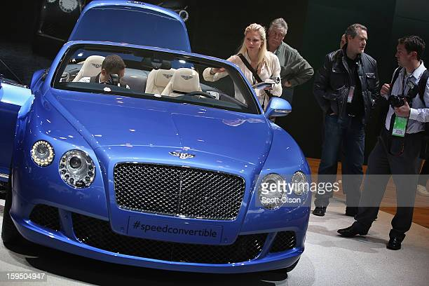 Visitors look over a 202 MPH Bentley Continental GT Speed Convertible during the media preview at the North American International Auto Show on...