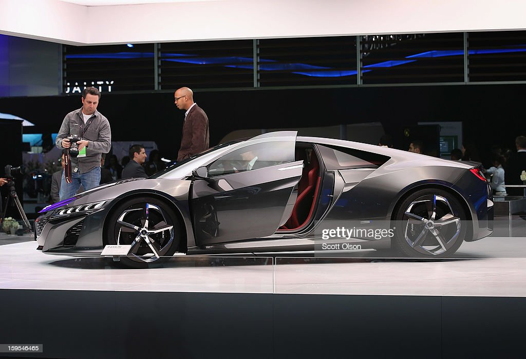 Visitors look over Acura's NSX concept which was developed and manufactured in the United States, during the media preview at the North American International Auto Show on January 15, 2013 in Detroit, Michigan. The auto show will be open to the public January 19-27.