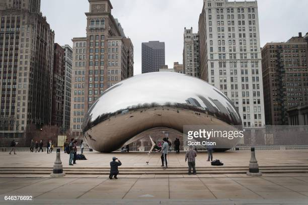 Visitors look over the Cloud Gate sculpture in Millennium Park on February 28 2017 in Chicago Illinois For the first time since the city has been...