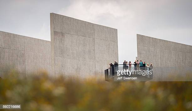 Visitors look over the flight path of Flight 93 at the Flight 93 National Memorial in Shanksville Pennsylvania on August 19 2016 American Airlines...
