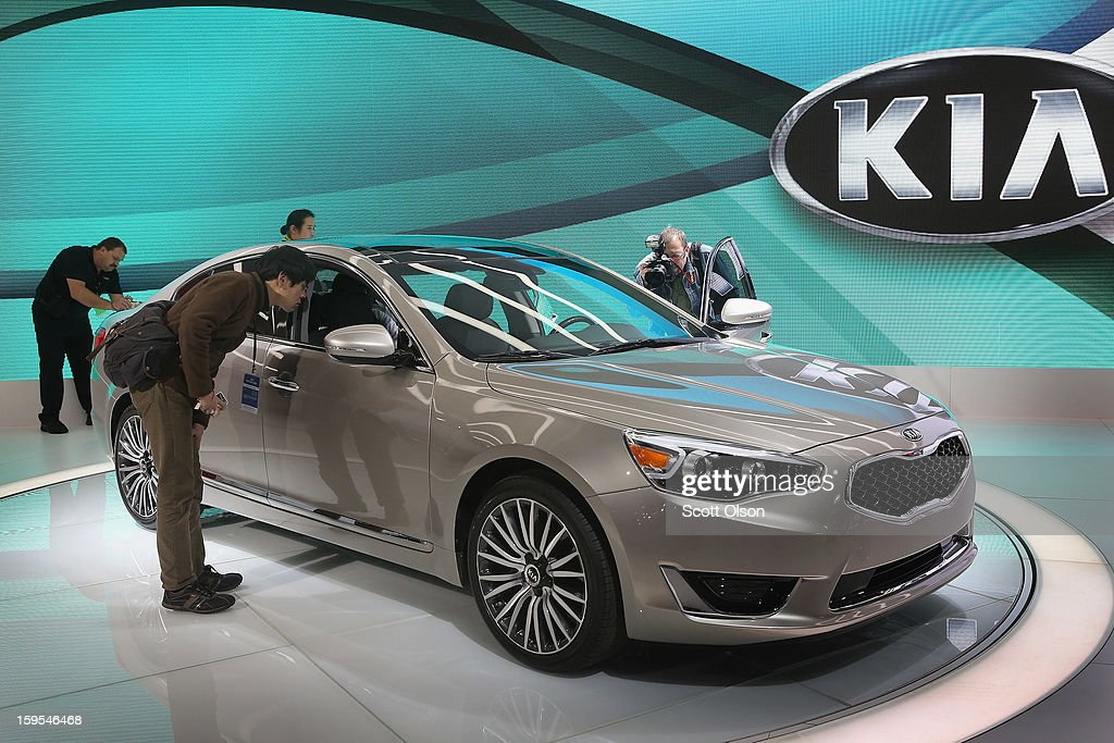 Visitors look over the new Kia Cadenza following its introduction during the media preview at the North American International Auto Show on January 15, 2013 in Detroit, Michigan. The auto show will be open to the public January 19-27.