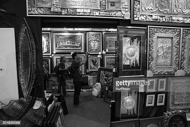 Visitors look painting works in the Jakarta International Handicraft Trade Fair in Jakarta Indonesia on April 10 2015 The 17th Jakarta International...