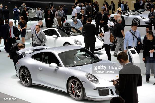 Visitors look Porsche 911 cars at the IAA international automobile show on September 11 2013 in Frankfurt Germany The 2013 IAA will be open to the...