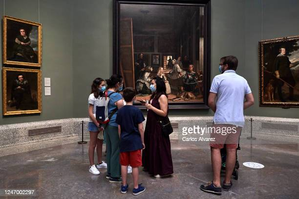 Visitors look the Velazquez's paintings during the reopening of the Prado Museum after its closure in the middle of March because of the Covid19...