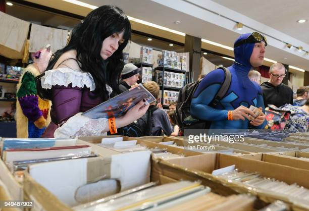 Visitors look through comic books at a stall during the Scarborough Sci-Fi event held at the seafront Spa Complex on April 21, 2018 in Scarborough,...