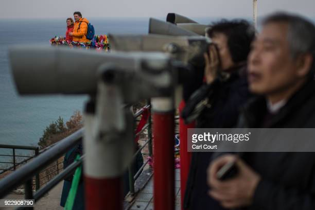 Visitors look towards North Korea as they visit Goseong Unification Observatory near the Korean Demilitarized Zone on February 22 2018 in Goseonggun...